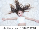 Small photo of kid girl lie down