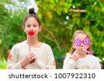 surprised little girl holding... | Shutterstock . vector #1007922310