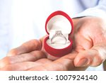 young man proposing  holding... | Shutterstock . vector #1007924140