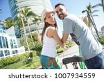 couple of tourists riding bike... | Shutterstock . vector #1007934559