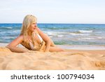 beautiful young woman lying on... | Shutterstock . vector #100794034