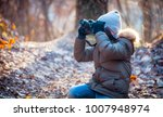 boy using digital camera taking ...   Shutterstock . vector #1007948974
