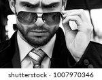 handsome businessman in a suit... | Shutterstock . vector #1007970346