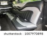back seat of a big luxury car... | Shutterstock . vector #1007970898