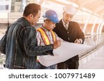 electrical engineer looking at... | Shutterstock . vector #1007971489