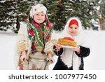 two little girls in fur coats... | Shutterstock . vector #1007977450