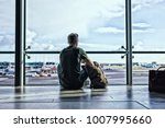 Man sitting in airport - stock photo