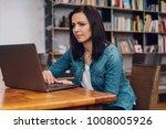 attractive woman sitting... | Shutterstock . vector #1008005926