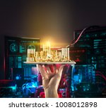 Stock photo hand holding mobile tablet with stack of bitcoin coins against the background of computer circuit 1008012898