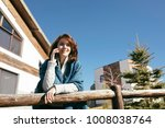 young woman talking on phone   Shutterstock . vector #1008038764