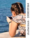 woman with phone takes photo on ...   Shutterstock . vector #1008039364