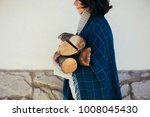woman wearing sweater and scarf ...   Shutterstock . vector #1008045430