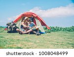 hipster couple resting in tent... | Shutterstock . vector #1008048499