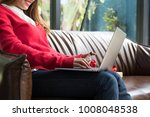 young woman holding credit card ...   Shutterstock . vector #1008048538