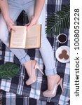 girl reading a book   Shutterstock . vector #1008052228
