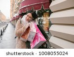 shopaholic girl calls packages   Shutterstock . vector #1008055024