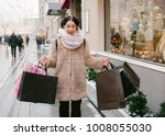 girl with packages goes down...   Shutterstock . vector #1008055030
