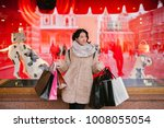 girl with packages goes down...   Shutterstock . vector #1008055054