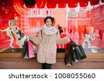 girl with packages goes down...   Shutterstock . vector #1008055060