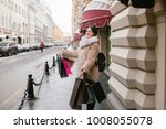 a girl holds many packages on...   Shutterstock . vector #1008055078