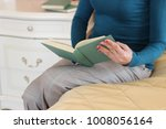 beautiful girl is reading a...   Shutterstock . vector #1008056164