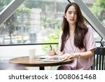 young asian business owner...   Shutterstock . vector #1008061468