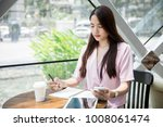 young asian business owner...   Shutterstock . vector #1008061474
