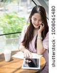 young asian business owner...   Shutterstock . vector #1008061480