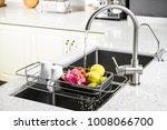 the sink mixer in the kitchen... | Shutterstock . vector #1008066700