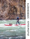Small photo of Paddling a sup down a whitewater river in the Northwest Territories, Canada.