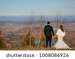 bride and groom posing on the... | Shutterstock . vector #1008086926