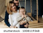 mom and dad play with charming... | Shutterstock . vector #1008119368