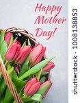 bouquet of tulips in basket on... | Shutterstock . vector #1008138853