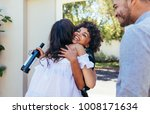 woman greeting couple for