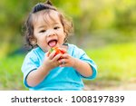 little girl happy eating tomato ... | Shutterstock . vector #1008197839
