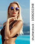 young model girl in black bikini | Shutterstock . vector #1008202348