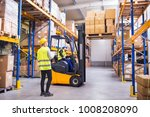 young warehouse workers working ... | Shutterstock . vector #1008208090