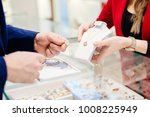 man buying necklace in jewelry... | Shutterstock . vector #1008225949