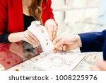 man buying gift in jewelry... | Shutterstock . vector #1008225976