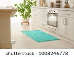 colorful rug on floor in kitchen | Shutterstock . vector #1008246778