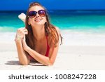 longhaired woman in bikini... | Shutterstock . vector #1008247228