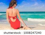 woman in bikini relaxing at... | Shutterstock . vector #1008247240