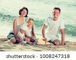 joyful young family of four... | Shutterstock . vector #1008247318