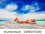 woman in bikini relaxing at... | Shutterstock . vector #1008247630