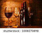 bottles with red wine and wine... | Shutterstock . vector #1008270898