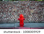 A Deep Red Fire Hydrant Sits I...