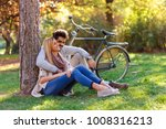 young couple in love sitting in ... | Shutterstock . vector #1008316213