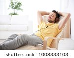 young man listening to music... | Shutterstock . vector #1008333103