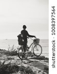 Small photo of Father and child biking on beach coastline outside nature background. Blurred outdoors image of active family bike ride. Healthy activity lifestyle, having fun travel vacation. Back view, book cover