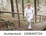woman climbing stairs during... | Shutterstock . vector #1008405724